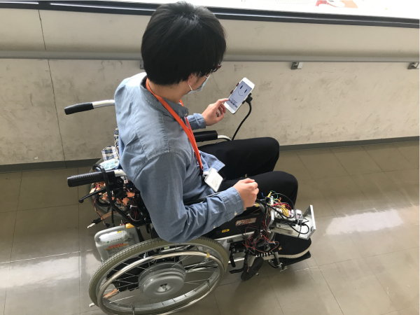 Development of a Control System and Interface Design Based on an Electric Wheelchair