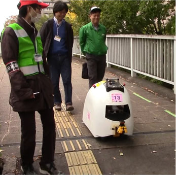 Autonomous Mobile Robot Navigation Using Scene Matching with Local Features