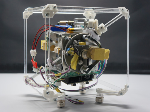 MACROTIS: Cubic Robot with Snap-Through-Buckling Mechanisms for Achieving High Freedom of Movement