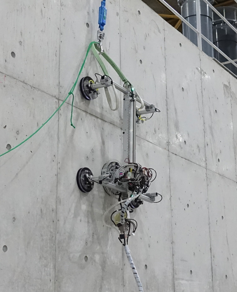 Development of Concrete Inspection Robot with Dual Stage Suckers