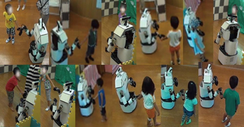 Walking Hand-in-Hand Helps Relationship Building Between Child and Robot