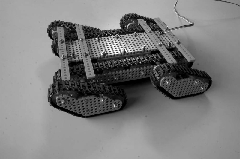 Improvement of the Mobility on the Step-Field for a Stair Climbable Robot with Passive Crawlers