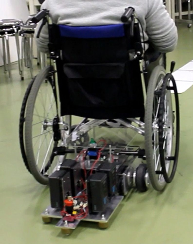 Study on Automatic Operation of Manual Wheelchair Prototype and Basic Experiments