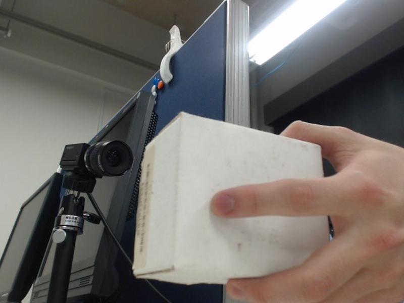 Vision-Based Finger Tapping Detection Without Fingertip Observation