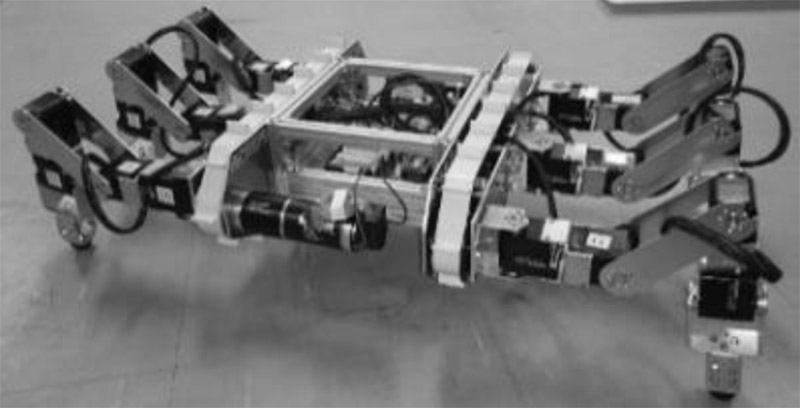 Gap Traversing Motion via a Hexapod Tracked Mobile Robot Based on Gap Width Detection